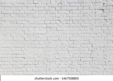 Old rough white brick wall texture for background