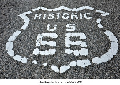 Old route 66 logo painted on asphalt