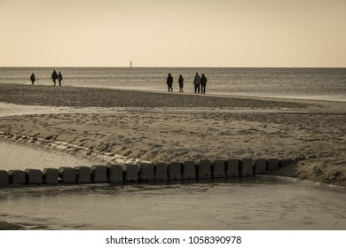 Old row of stones, built as a breakwater on the western beach of Sylt island, Germany, sepia effect