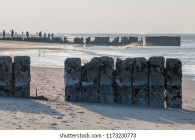 Old row of stones, built as a breakwater on the western beach of Sylt island, Germany