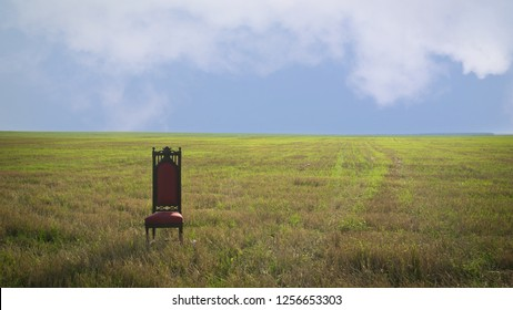 Old Royal throne in a summer field