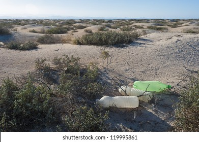 Old rubbish discarded on a remote desert island concept environmental issues