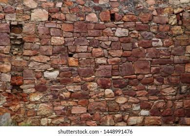 Old ruin building rockface wall near Hout Bay