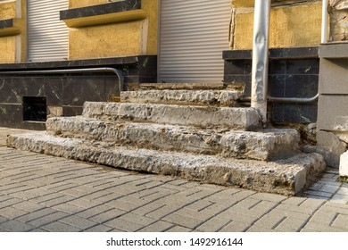 Old ruined concrete stairs before renovation works.