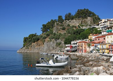 old ruined fortress on hill and colorful buildings Parga Greece