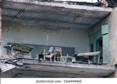 """Old ruined house in Pripyat in Chernobyl. Translation:""""Komsomol corner. Our city have place in history."""""""