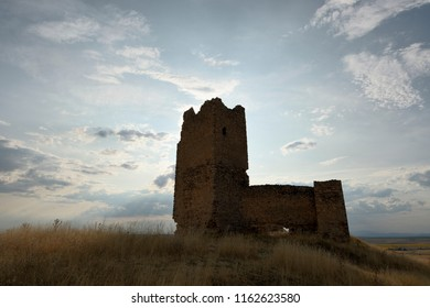 Old ruined medieval castle against backlight