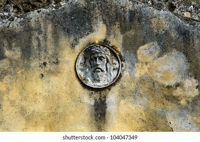 old, ruined, wall with a bas-relief of jesus christ