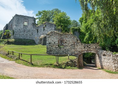 Old ruins of a fortress. Public park and the ruins of the medieval rocca (fortress) Borromea of Arona above the city overlooking lake Maggior, Italy