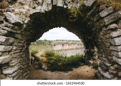 Old ruins of Skala Podilskyi castle, Ukraine. Destroyed ruined stone walls of medieval castle and green grass, historical defence fortress in Europe - Shutterstock ID 1651964530