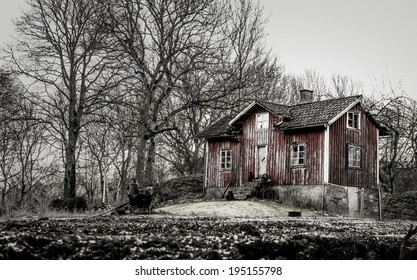 Old run down, ramshackle farm house in muted tones