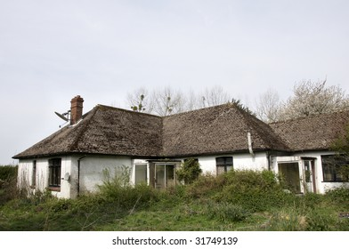 An old run-down and abandoned bungalow in the English countryside