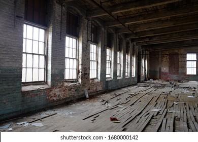 Old rundown warehouse with windows.