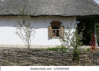 Old rural house with a fence and a garden