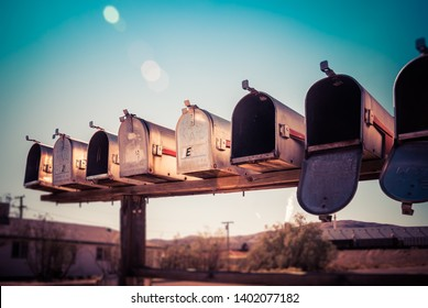 Old rural mail boxes on the side of the road.