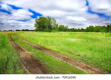 old rural road and cloudy blue sky