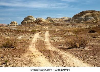 Old rural road in desert place named Kiin-Kerish  in eastern Kazakhstan