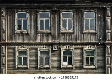 Old russian traditional wooden house with the carved windows. Rundown house. Village of Visim, Sverdlovsk oblast, region of Ural, Russia.