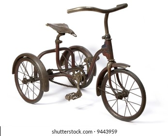 Old and rust iron tricycle.