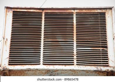 old rusted broken air conditioner fan