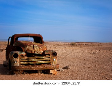 Old rusted car desserted in the dessert