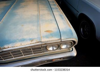 old rusted car in junkyard