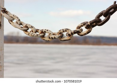 old rusted chain on the river wharf