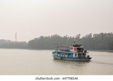 old rusted cruise boat in sundarbans bangladesh