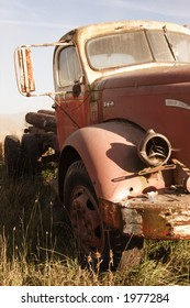 An old rusted farm truck from the forty's.