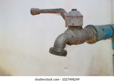 Old rusted faucet leakage.