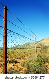 Old rusted fence in a deserted field