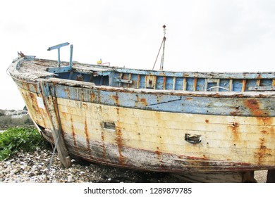 old rusted fishing boats abandoned on the land.