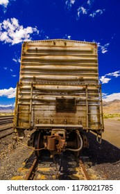 Old rusted freight train on railroad tracks in Wendover, Utah, USA.