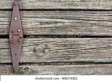 Old rusted hinge holding floating wooden dock together