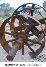 Old, rusted line shaft probably used in the stamp mill for mining gold.  Delamar, Nevada. 2009.