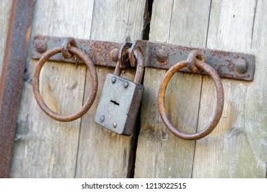 Old rusted lock on  huge wooden doors