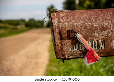 Old Rusted Mailbox on Country Dirt Road, Red Flag, postal service, mail delivery