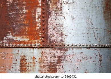 Old rusted metal background texture with rivets