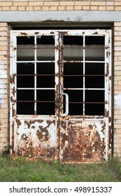 Old rusted metal door, closed and abandoned