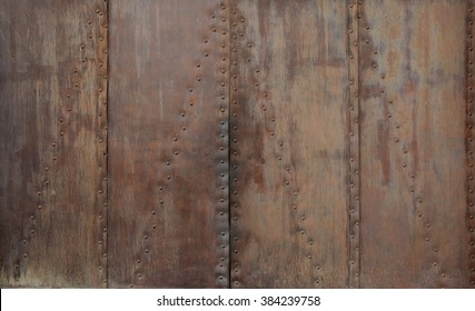 Old rusted metal riveted texture