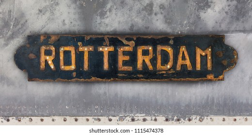 Old rusted steel ship plate with an imprint of the Dutch city of Rotterdam