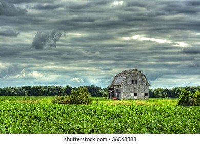 Old rustic barn next to field done in hdr