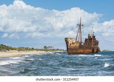Old rustic big ship. Blue sky