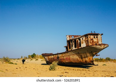 Old rustic boats and ships in a desert around Moynaq, Muynak or