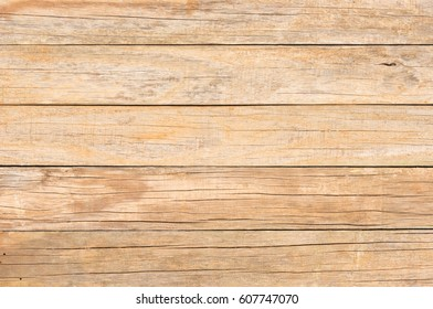 Old rustic brown wood wall background texture.