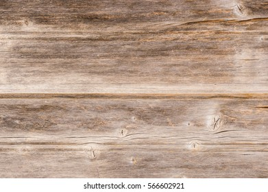 Old rustic brown wooden grain surface texture.