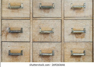Old rustic cabinet with small compartments