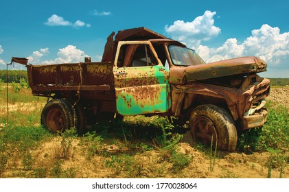 Old rustic Chevy farm truck with green door used for target practice near an abandon farm near Westover Maryland Somerset County