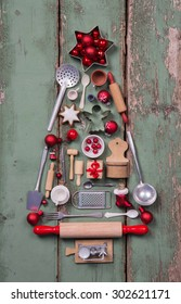 Old rustic children toys decoration for christmas in form of a tree in red , silver, green and brown colors.