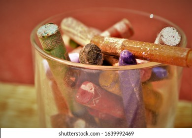 old rustic crayons artistically stacked in a transparent glass